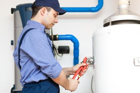 Employee-repairing-a-hot-water-heater