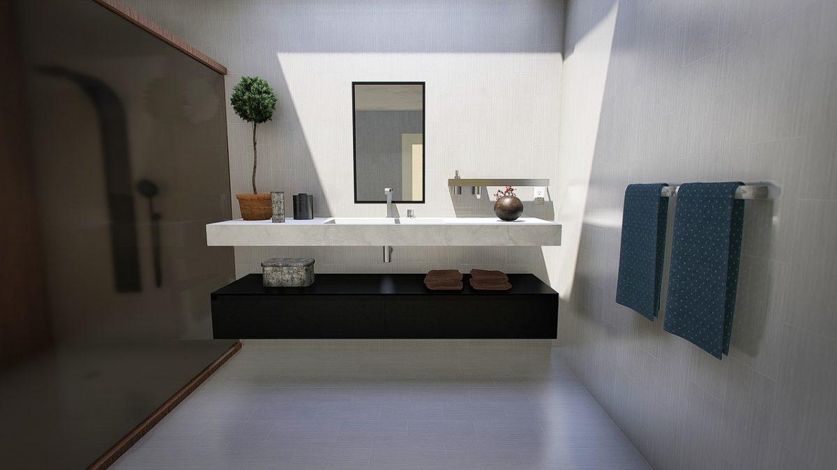 décorer une salle de bain en installant une barre de sèche-serviette